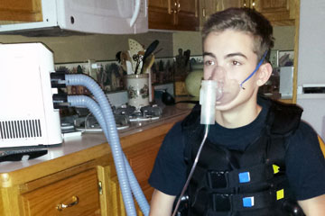 Cystic fibrosis patient receiving vest treatment